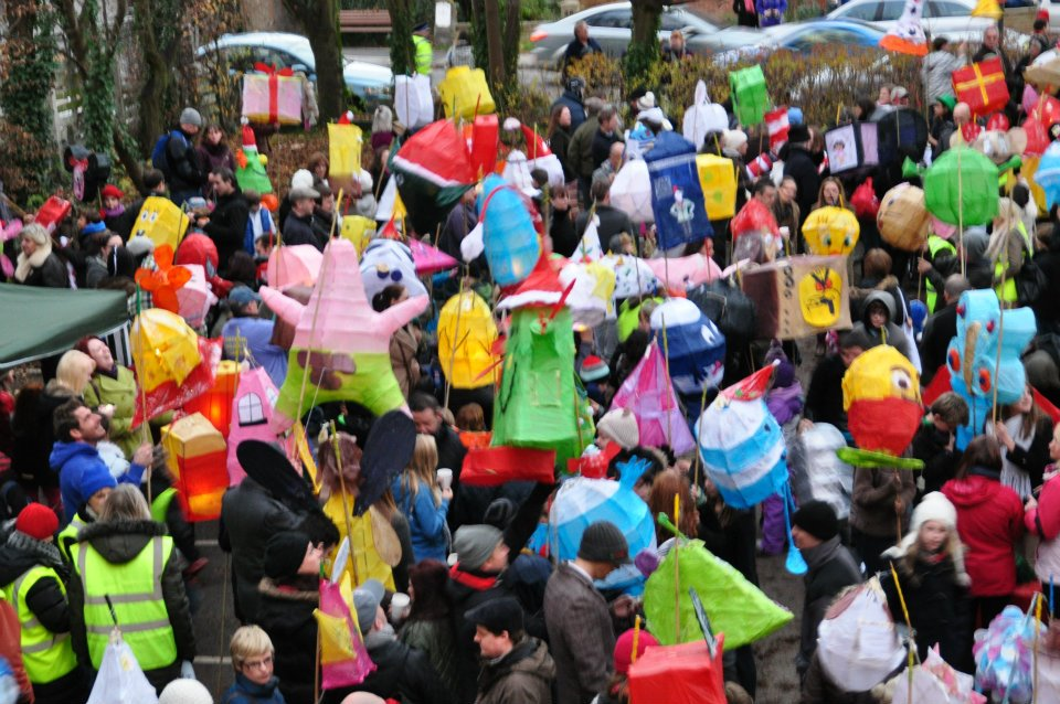 aerial shot of the Stony Stratford lantern parade with a crowd of people with coloured paper lanterns