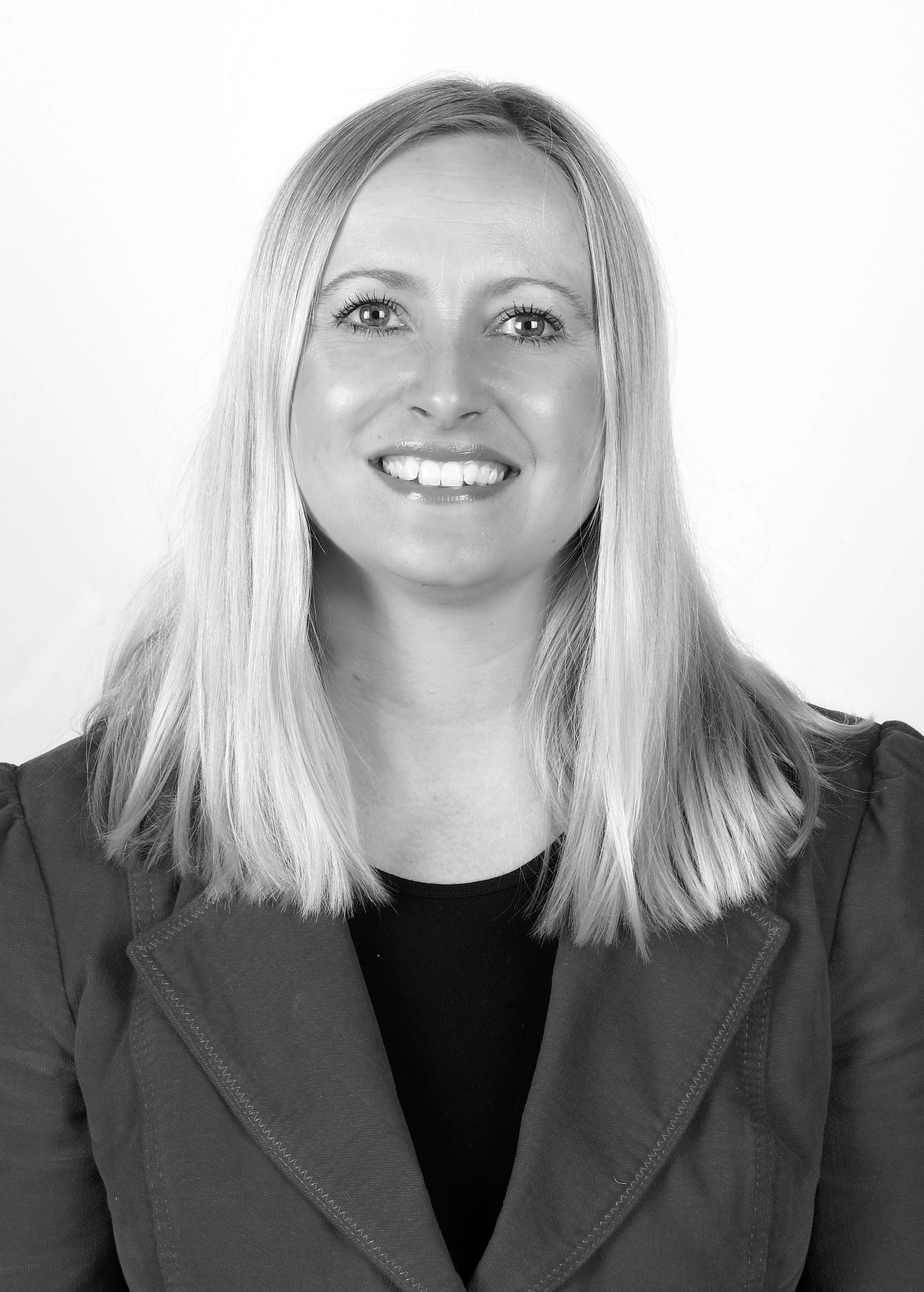 black and white head and shoulders photo of the Information Officer Melanie Hyde