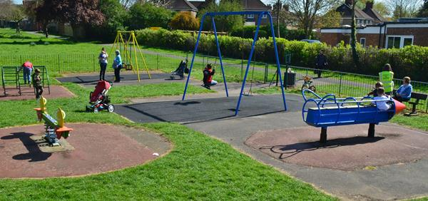 Wolverton Road recreation ground showing play equipment and children playing on it