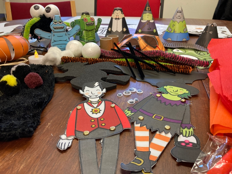Selection of Halloween children's crafts laid out showing lots of puppets