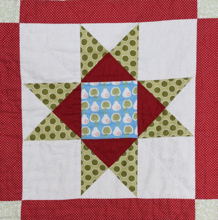 Introduction to Patchwork workshop. Patchwork quilt showing Ohio star pattern.
